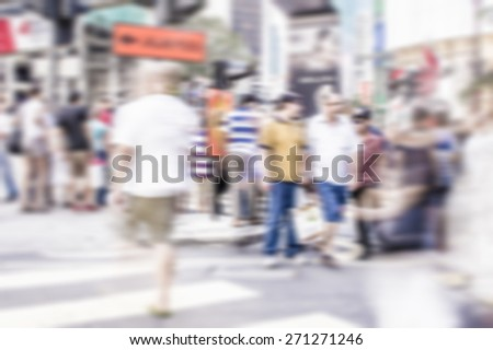 Busy people on street in defocused blur concept with vintage  color style and effects. - stock photo