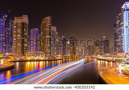 Busy promenade and the bay in luxury Dubai Marina in the evening,Dubai,United Arab Emirates - stock photo