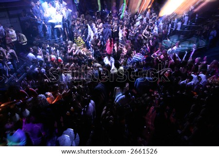 BUSY RAVE DANCEFLOOR FULL OF CLUBBERS AND RAVERS DANCING TO LOUD MUSIC - stock photo