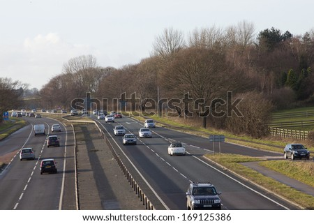 busy road in winter sun - stock photo