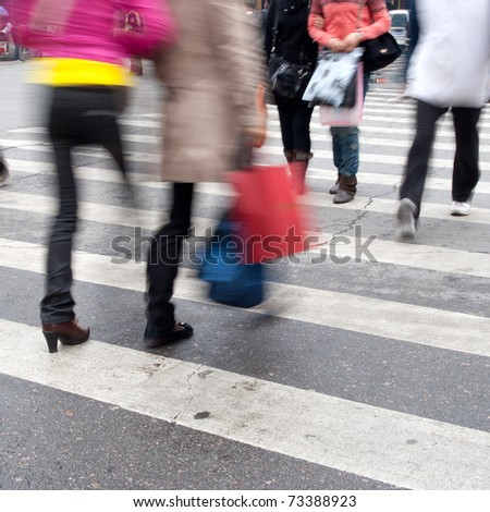 Busy street in China. Purposely blurred with a lens. - stock photo