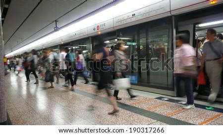 Busy subway station in Hong Kong  - stock photo