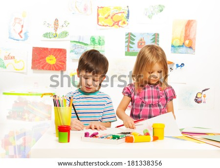 Busy three and four years old  creative boys and girls - stock photo