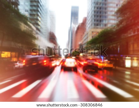Busy traffic cars are driving in the city street with a blurred effect for a background transportation concept. - stock photo