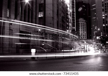 Busy traffic in Hong Kong at night in black and white - stock photo