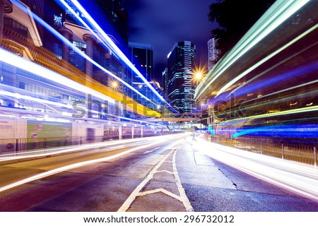Busy traffic in Hong Kong city at night - stock photo