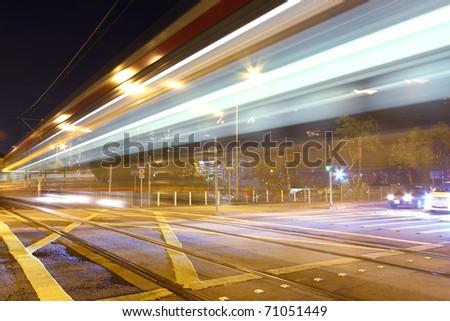 Busy traffic through downtown of Hong Kong at night - stock photo