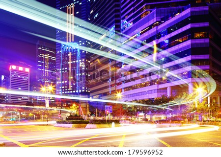 Busy traffic trail in city - stock photo