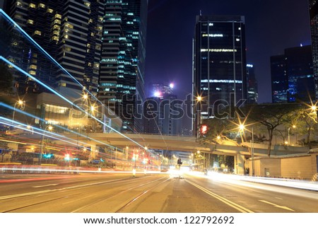 busy vehicle movement -downtown buildings in hong kong highway - stock photo