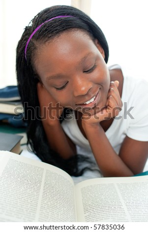 Busy woman reading a book with thumb up - stock photo