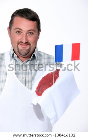 Butcher holding French beef - stock photo