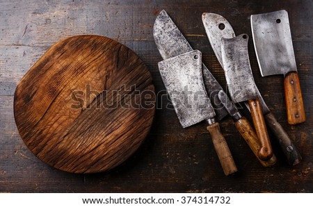 Butcher Meat cleavers large chef's knives and Chopping board block on wooden background - stock photo