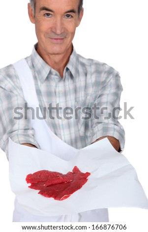Butcher showing meat on white  background - stock photo