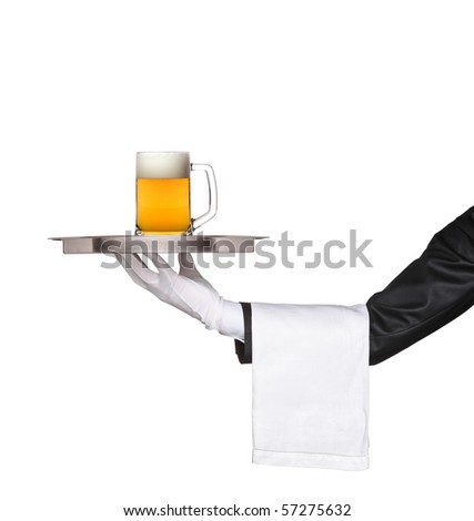 Butler holding a tray with a beer glass on it isolated on white - stock photo