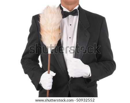 Butler in a tuxedo Holding a duster isolated on white torso only