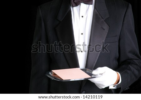 Butler in Tuxedo Holding a Silver Tray and Envelope