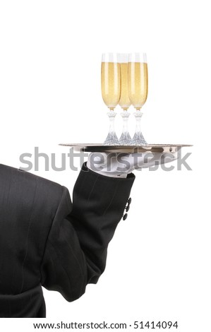 Butler in Tuxedo seen from behind with three champagne glasses on serving ray held at shoulder height vertical format over white - stock photo