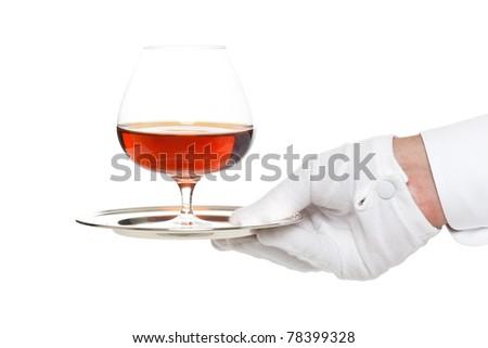 Butler serving a glass of liquor - stock photo
