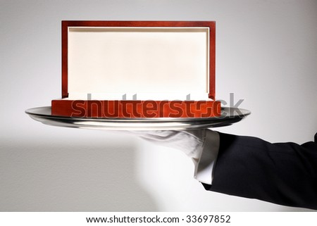 Butler serving Luxury Wooden Gift Box - stock photo