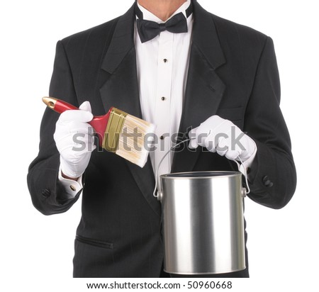 Butler wearing a tuxedo holding a Paint can and Brush isolated on white. Square format showing only the persons torso. - stock photo