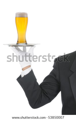 Butler wearing tuxedo and formal gloves holding a beer glass on a silver tray. Shoulder hand and arm only isolated on white vertical composition. - stock photo