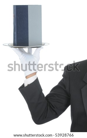 Butler wearing tuxedo and formal gloves holding a book on a silver tray. Shoulder hand and arm only isolated on white vertical composition. - stock photo