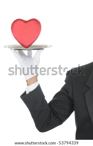 Butler wearing tuxedo and formal gloves holding a heart shaped box on a silver tray. Shoulder hand and arm only isolated on white vertical composition.