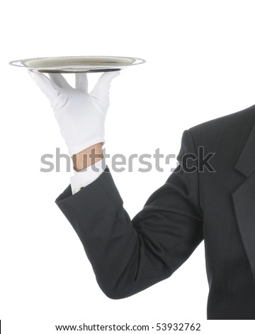 Butler wearing tuxedo and formal gloves holding a silver tray. Shoulder hand and arm only isolated on white vertical composition. - stock photo