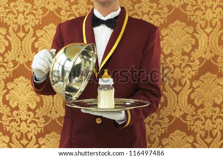 Butler with Silver Tray and Bottle of Milk - stock photo