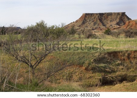 butte in the distance in northwest Oklahoma - stock photo