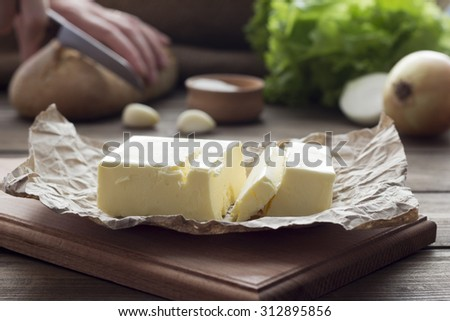 butter and Products, sliced �¢??�¢??bread in the background
