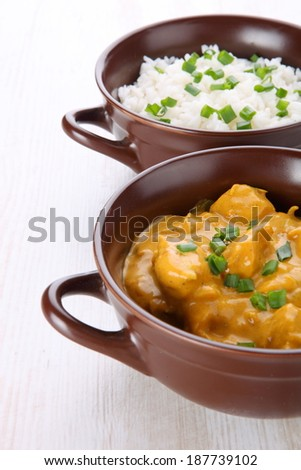 Butter chicken curry with basmati rice.  - stock photo
