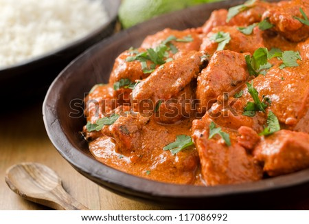 Butter chicken curry with basmati rice and limes. - stock photo