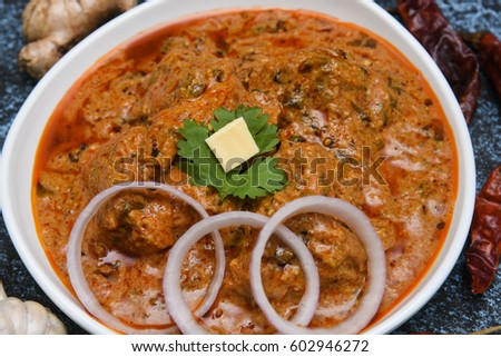 Butter Chicken /Karahi curry/tikka masala/Korma and ingredients, hot and spicy gravy dish Pakistan, North India. Non-vegetarian food prepared using Indian spices/masala. Sidedish chapati/roti/paratha