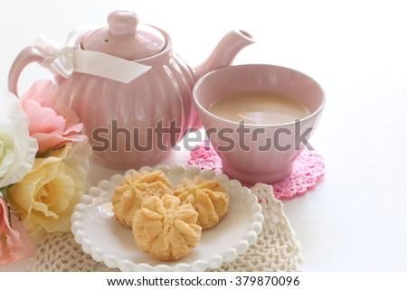 butter cookie on white dish with milk tea - stock photo