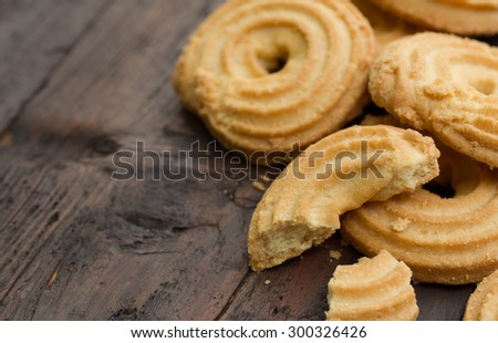 Butter Cookies on wood table - stock photo