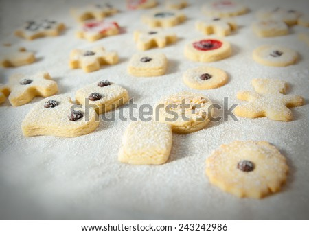 butter cookies with icing sugar paper on its surface - stock photo