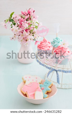 Butter cream cupcakes and cookies for a baby shower - stock photo