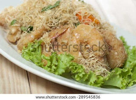 butter fried prawn with green salad - stock photo