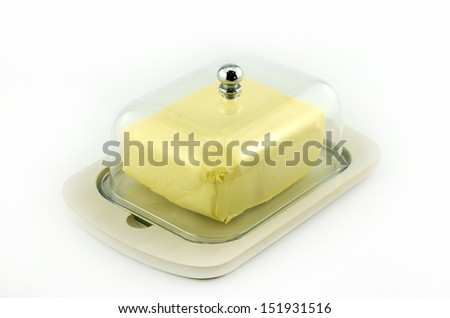 Butter in plastic transparent box isolated on white background - stock photo