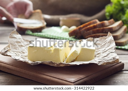 butter on a blackboard in the background and make a sandwich - stock photo