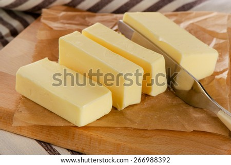 Butter on a  cutting board. Selective focus - stock photo