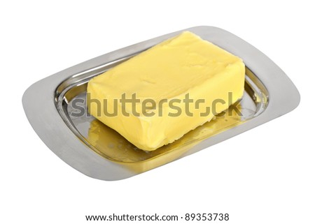 Butter on silver butter dish isolated on white background - stock photo