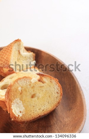 butter on slided french bread