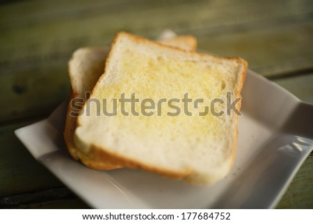 Butter toast on white dish