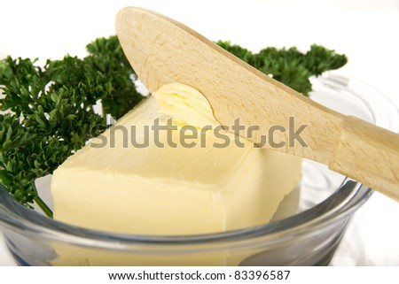 Butter with knife on the plate - isolated - stock photo