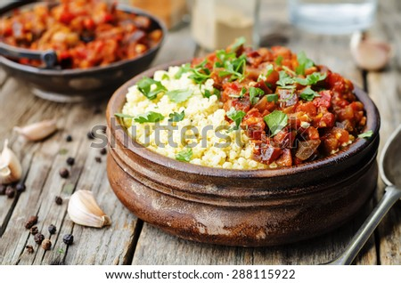 buttered millet with tomato eggplant curry. the toning. selective focus
