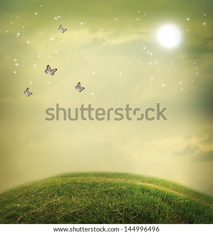Butterflies in the fantasy hilltop landscape with moon - stock photo