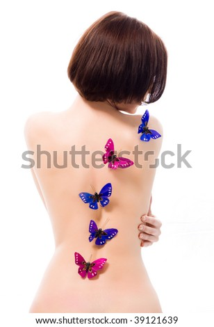 Butterflies on the back of a girl - stock photo