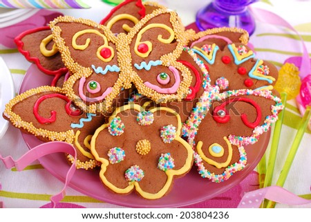 butterfly and flower shaped gingerbread cookies for summer party - stock photo